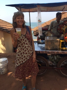 Huggie drinking fresh cane juice in her new silk dress
